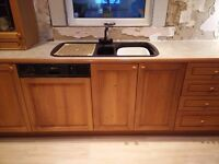 Oak kitchen units and kitchen appliances