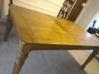 Solid extendable dining table. Good condition.