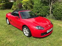 MG TF red 2 seater sports car