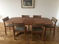 Vintage Dyrlund Teak Extendible Dining Table and Chairs in Good Condition