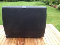 2 Rigid Suitcases with wheels. Good condition. 79x63x26cms. Combination locks. 100 Litre capacity