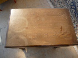 Dark wood table with leaves, shelf and drawer