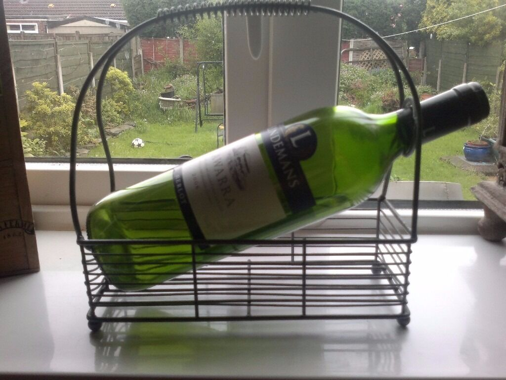 METAL WINE BOTTLE HOLDER NICEin Denton, ManchesterGumtree - LOVELY METAL WINE POURER FOR SALE. GOOD CLEAN CONDITION HOPE YOU LIKE. PLEASE VIEW MY MANY OTHER ITEMS FOR SALE. THANK YOU