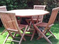Lovely octagonal teak table and 4 chairs