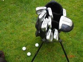 set of right hand golf clubs, bag, tees and balls