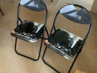 Two Padded Folding Chairs - Ideal for gatherings or last minute guests. Simple design