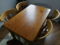 Light wood dinning table with 4 chairs