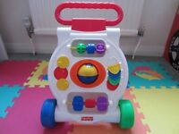 Baby walker in nearly new condition.
