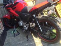Red Honda Motorcycle CBF 125
