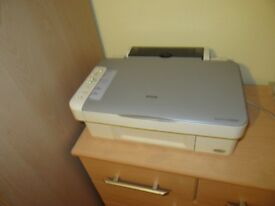 Epson 3 in 1 printer and cartridges for sale.