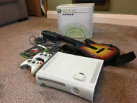 XBOX 360 60GB HDD, 2 hand controllers and Guitar Hero