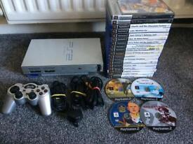 ps2 console (silver) with loads of games BARGIN