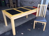 Teak table with 3 granite inserts and 4 chairs