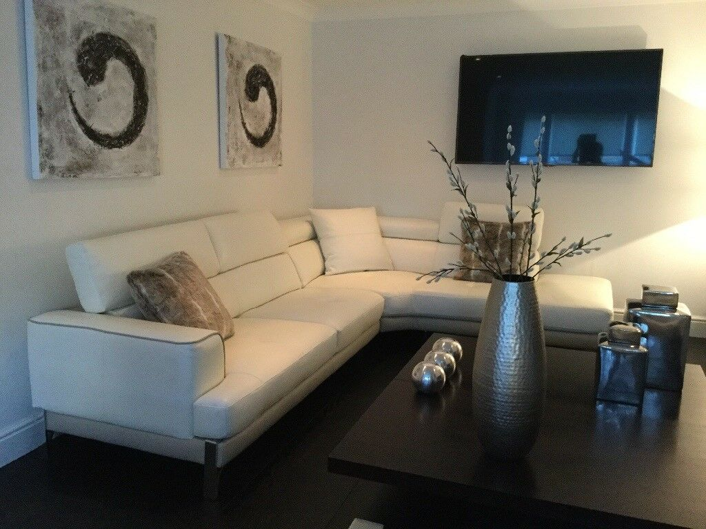 Modern cream leather sofa and matching armchairs