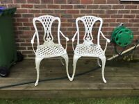 Two metal garden chairs