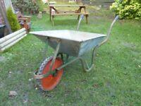 Galvanised wheel barrow.
