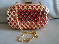 Glamourous, special occasion clutch bag with detachable chain strap