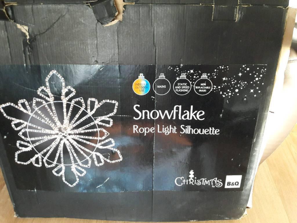 Pair of snowflake silhouette rope lights