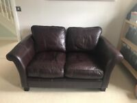 Pair of Dark Brown genuine leather compact 2 seater sofas.