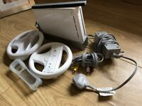 Nintendo Wii Console with cables, controller & two steering wheels