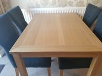 Wooden table & stylish fabric chairs