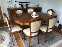 Round, Extendable to Oval, Dining Table and Six Chairs.