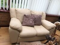 2 2 seater leather sofas in cream. Good condition collection only