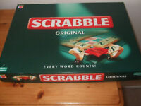 Scrabble Game Used but in clean condition A small amount of damage on one corner of the box