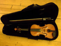 Small violin for sale with bow and case