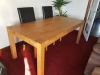 Solid oak dining table and 6 faux leather black chairs