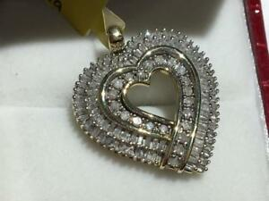#1465 10K YELLOW AND WHITE GOLD DIAMOND HEART SHAPE PENDANT WITH 1 CT TOTAL IN DIAMONDS. JUST BACK FROM APPRAISAL!