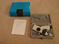 Manual lensometer to measure optics of pairs of glasses. Model JC-1