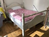 White wooden distressed double bed