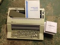 Nakajima AE 610 Electric Typewriter & 5 new ribbons