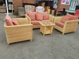Large cane conservatory suite with coffee table