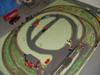Electric train set with accessories set on a wooden board measures max 5 ft 3 inch x 3 ft 6 inch