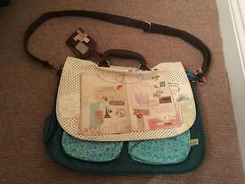 Accessorize funky travel theme satchel