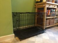 Wire dog crate 30 inch. No assembly; fully collapsible. Doors front and side. Removable tray.