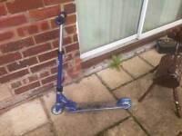 Blue JD Bug scooter