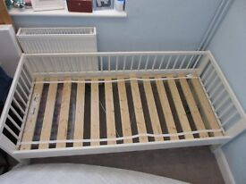 Small white childs' bed, matress and two white fitted sheets