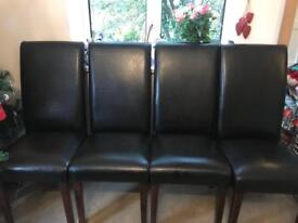 4 Black leather chairs .Bargain!