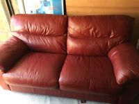 2x Genuine red leather sofas/ sofa bed