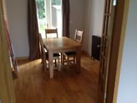 Extendable Solid Oak Dining Table and Chairs seats 8 people