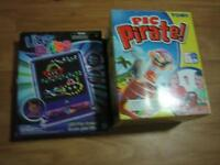 various toys and playdough set and dry erase books & games