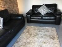 3&2 black leather sofas / can deliver