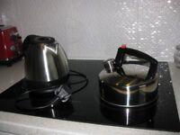 2 Stainless steel kettles.