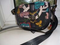 small cross body bag unusual pattern on it