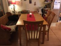A smart set of dining table and 6 chairs in a very good condition.
