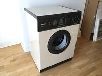 Hotpoint Aquarius TL21 vented tumble dryer
