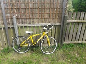 Kids dropped handled bike.sShimano 7 gear.Only been used once.Yellow